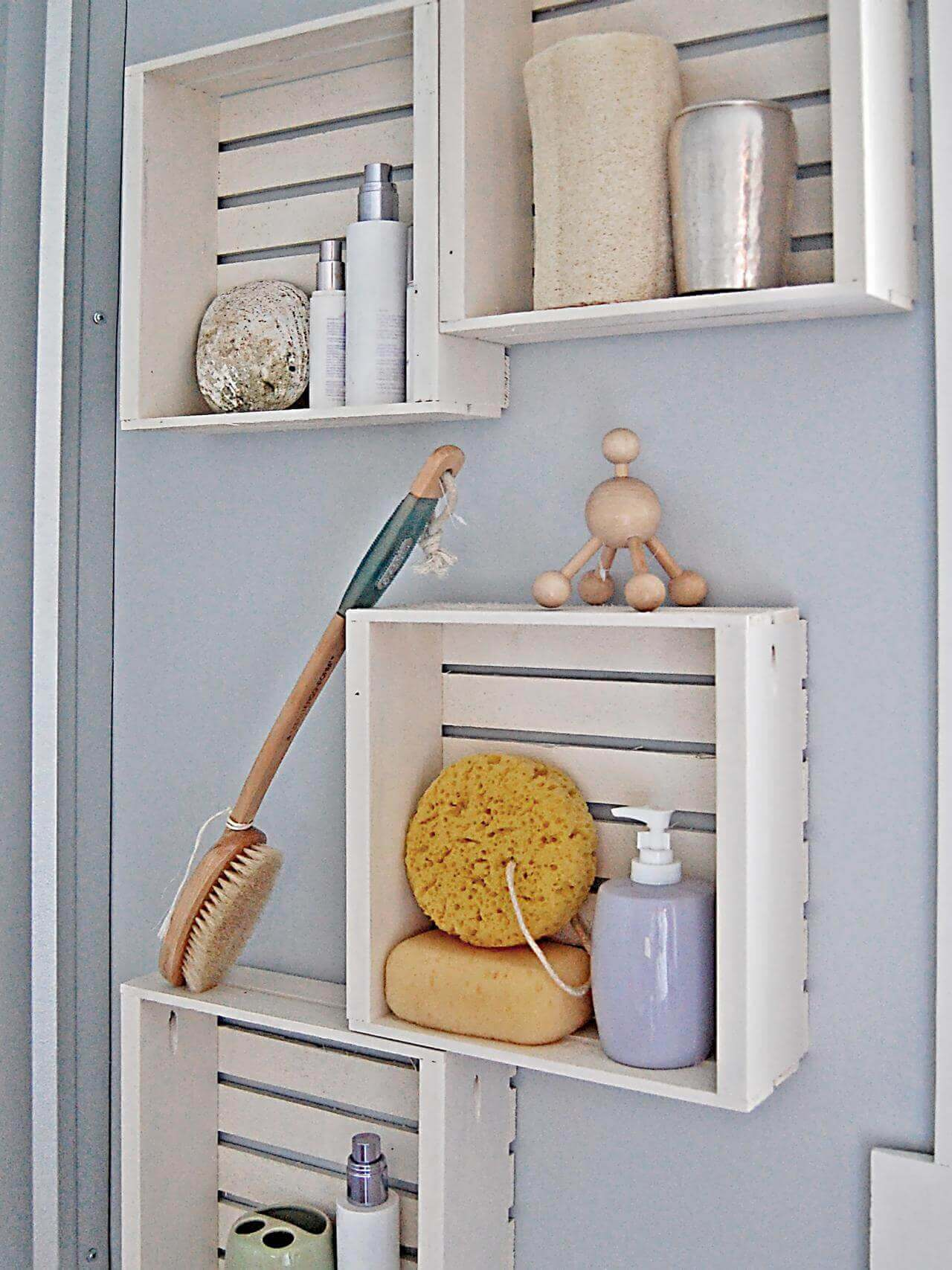 hang crates on bathroom wall