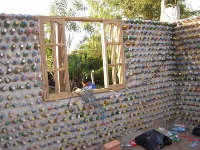 Incredible Bottle House, Look on birdhouse house designs, wooden doll house designs, box house designs, miniature house designs, pump house designs, playing card house designs, toothpick house designs, glass house designs, tube house designs, boxcar house designs,